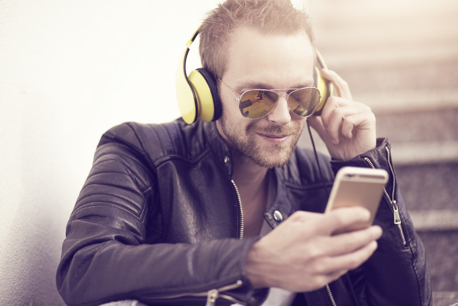 a Man with smartphone - how to increase podcast listeners