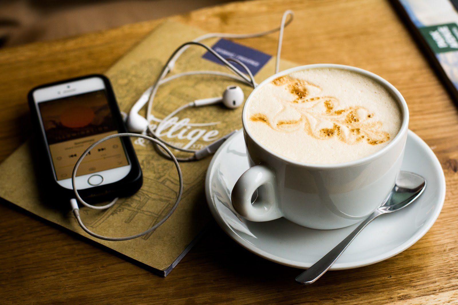 Preparing to using phone while drinking coffee